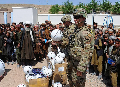 Aussie soldiers in Afghanistan delivering the soccer balls to the kids