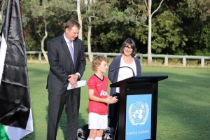 Mac speaking at a UN event with Mr Craig Laundy MP and Ms Maria Vamvakinou MP