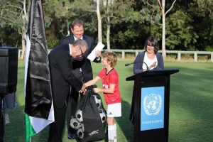 Mac presenting soccer balls to the Ambassador from Palestine